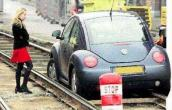 Car on the train track